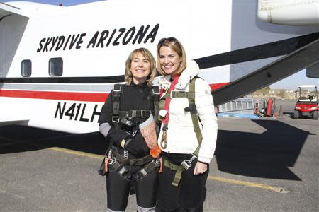 Former U.S. Congresswoman Gabrielle Giffords (L) is pictured with Savannah Guthrie of NBC's TODAY show in this handout photo from Gifford's skydive released by NBC's TODAY show on January 8, 2014. REUTERS/NBC's TODAY show/Handout via Reuters
