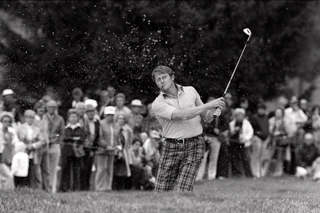 Britain's Brian Barnes, pipe in mouth, follows through Sept. 21, 1975 after blasting out of a sand trap during Ryder Cup match at Laurel Valley Golf Club, Ligonier, Pa. Barnes beat Jack Nicklaus twice on the final day of the competition, 4 and 2 in the morning, and 2 and 1 in the afternoon. But the U.S. won the competition, 21 points to 11. (AP Photo/RAD)