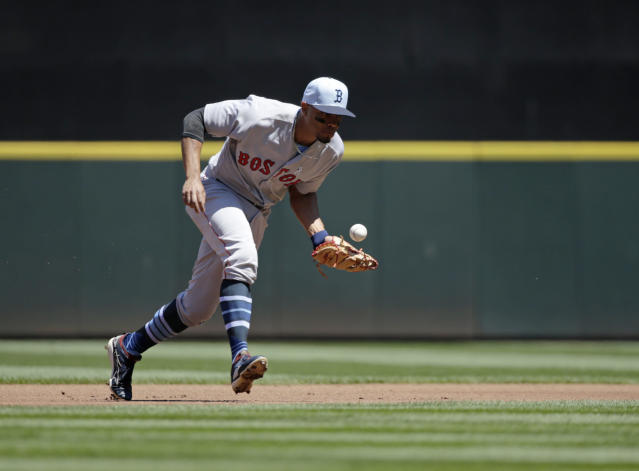 Boston Red Sox shortstop Xander Bogaerts bobbles a ball hit by Seattle Mariners' Dee Gordon during the first inning of a baseball game, Sunday, June 17, 2018, in Seattle. (AP Photo/John Froschauer)