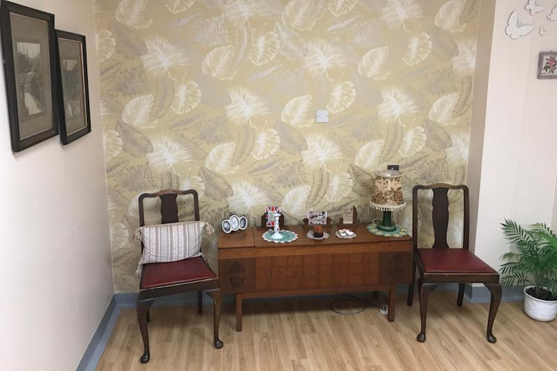 Royal Preston Hospital's 1940s style reminiscence room, featuring pictures of ration books and old photographs (PA)