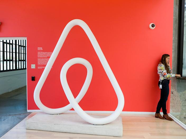 "A woman talks on the phone at the Airbnb office headquarters in San Francisco. <p class=""copyright"">Reuters</p>"