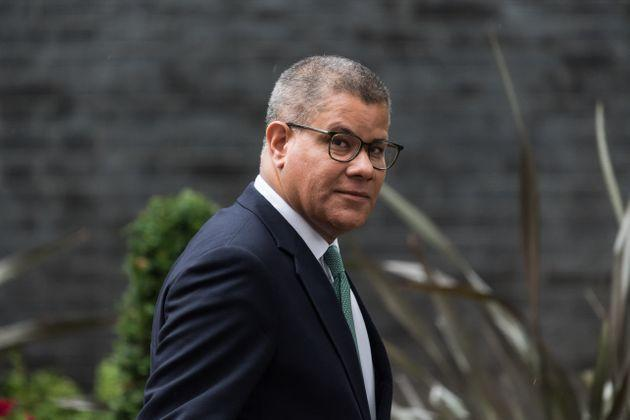 COP26 President Alok Sharma leaves after a weekly Cabinet meeting in London on Tuesday.He said the British government had offered to pay for quarantine hotel stays for registered delegates arriving from