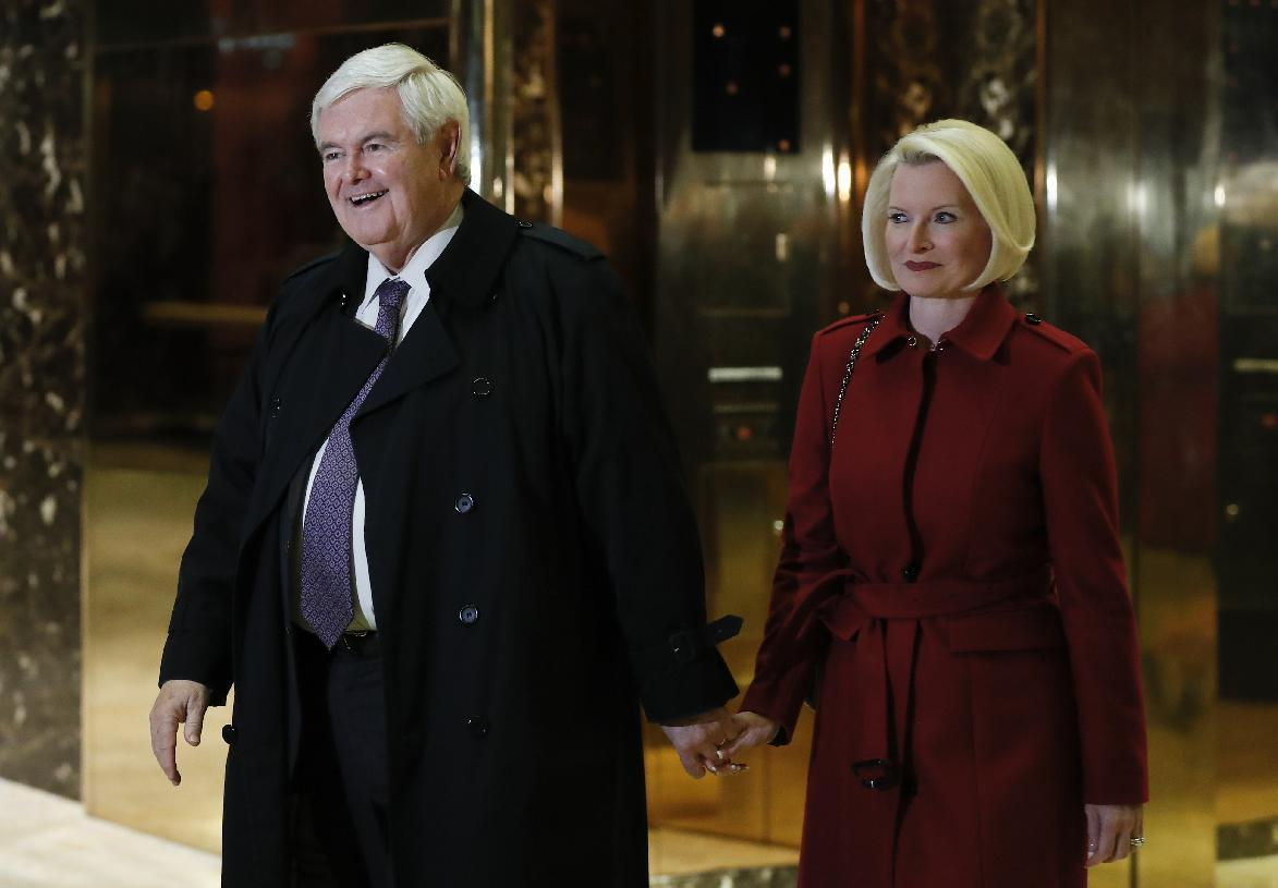 Former House Speaker Newt Gingrich and his wife Callista Gingrich walk to talk with media at Trump Tower, Monday, Nov. 21, 2016, in New York after meeting with President-elect Donald Trump. (AP Photo/Carolyn Kaster)