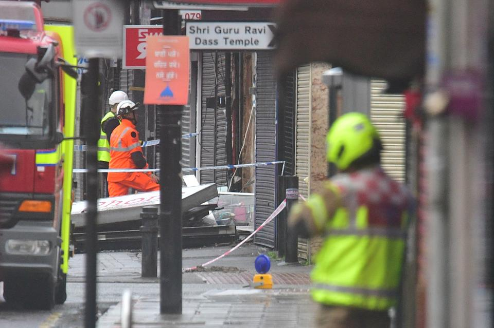 "Emergency services inspecting damage at the scene of a suspected gas explosion on King Street in Ealing, west London. Rescuers are involved in a ""complex"" search for anyone who may still be inside the collapsed building."