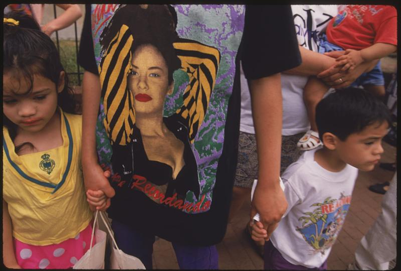 Mother (wearing a Selena t-shirt) and children at the Mount Pleasant Day Festival. (Photo by © Shepard Sherbell/CORBIS SABA/Corbis via Getty Images)