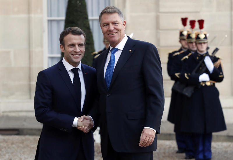 FILE - In this file photo dated Tuesday Nov. 27, 2018, French President Emmanuel Macron, left, greets Romanian President Klaus Iohannis at the Elysee Palace in Paris. Romania will take over the rotating presidency of the European Union on Jan. 1, 2019, although President Klaus Iohannis said last month that Romania wasn't up to the job. (AP Photo/Christophe Ena, FILE)