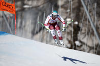 Austria's Vincent Kriechmayr speeds down the course on his way to win the men's downhill, at the alpine ski World Championships in Cortina d'Ampezzo, Italy, Sunday, Feb.14, 2021. (AP Photo/Gabriele Facciotti)