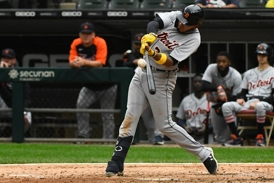 Detroit Tigers' Harold Castro hits a sacrifice fly RBI during the fifth inning of a baseball game against the Chicago White Sox, Sunday, Oct. 3, 2021, in Chicago.