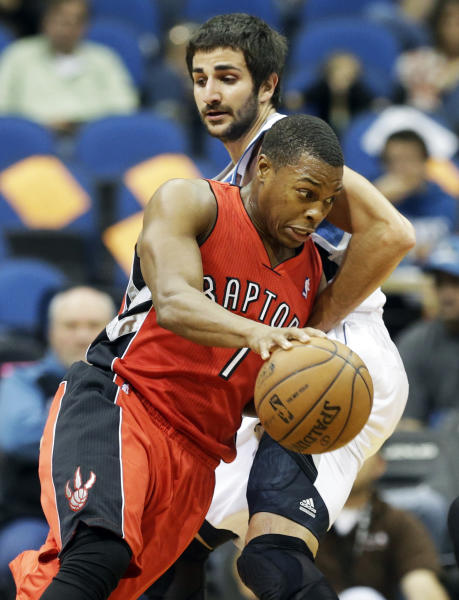 Toronto Raptors' Kyle Lowry, front, drives around Minnesota Timberwolves' Ricky Rubio, of Spain, in the first quarter of an NBA preseason basketball game on Saturday, Oct. 12, 2013, in Minneapolis. (AP Photo/Jim Mone)