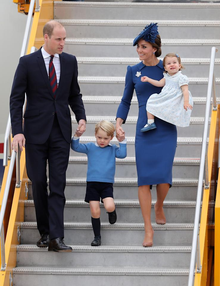 <p>Kate touched down in Canada wearing an elegant Jenny Packham dress, a matching blue maple leaf hat and suede Gianvito Rossi pumps. <br /><i>[Photo: PA]</i> </p>