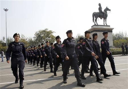 Thai police officers gather at the Royal Plaza near the Government House in Bangkok