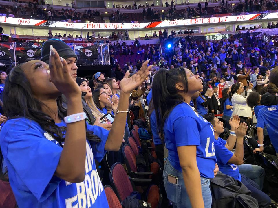 A Chicago Scholars student claps at the 2020 NBA All-Star Game. (Henry Bushnell/Yahoo Sports)