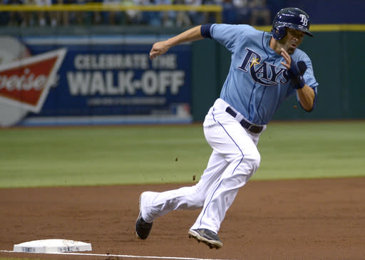 Tampa Bay Rays' David DeJesus rounds third base on his way to scoring on Evan Longoria's single during the first inning of a baseball game against the New York Yankees in St. Petersburg, Fla., Sunday, Aug. 25, 2013. (AP Photo/Phelan M. Ebenhack)