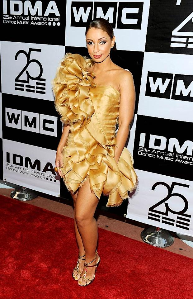 "Ruffles may be in style, but the brassy creation Mya modeled at the International Dance Music Awards in Miami took the trend a tad too far. Remember: wear the dress, don't let it wear you! Jemal Countess/<a href=""http://www.wireimage.com"" target=""new"">WireImage.com</a> - March 25, 2010"