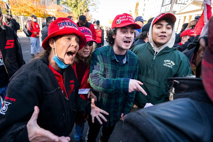 Supporters of US President Donald J. Trump clash with a supporter of President-elect Joe Biden in Black Lives Matter (BLM) plaza outside the White House ahead of an upcoming rally to support Trump's baseless claims of voter fraud in the 2020 presidential election in Washington, DC, USA, 13 November 2020. On 14 November, Pro-Trump and White Nationalist groups plan to converge on DC to protest the election. On 12 November, the Cybersecurity and Infrastructure Security Agency, a division of the Department of Homeland Security, stated 'the November 3rd election was the most secure in American history.'  EPA/JIM LO SCALZO (EPA)
