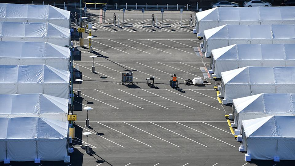 COVID-19 vaccination tents are set up in the north of the Toy Story parking lot at the Disneyland Resort on Tuesday, January 12, 2021, in Anaheim California