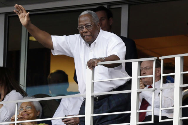 Hall of Famer Hank Aaron waves to the crowd during the MLB All-Star baseball Home Run Derby, Monday, July 9, 2012, in Kansas City, Mo. (AP Photo/Jeff Roberson)