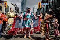 <p>Demonstrators participate in the Every Child Matters Walk on Canada Day, in downtown Toronto on Thursday, July 1, 2021. THE CANADIAN PRESS/Christopher Katsarov</p>