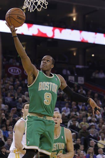 Boston Celtics' Rajon Rondo (9) lays up a shot against the Golden State Warriors during the first half of an NBA basketball game Wednesday, March 14, 2012, in Oakland, Calif. (AP Photo/Ben Margot)