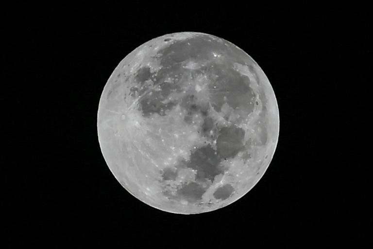 India's lunar mission is intended to help scientists understand better the origin and evolution of the Moon through studying the topography and minerals at the South Pole region (AFP Photo/Luis ROBAYO)