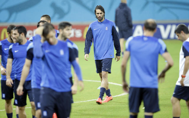 Greece's Giorgos Samaras, center, walks on the pitch during a training session of Greece in the Arena Pernambuco stadium, Recife, Brazil, Saturday, June 28, 2014. Greece will play Costa Rica in a World Cup round of 16 soccer match next June 29.(AP Photo/Andrew Medichini)
