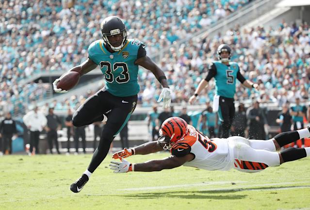 <p>Chris Ivory #33 of the Jacksonville Jaguars runs with the football over Vontaze Burfict #55 of the Cincinnati Bengals during the first half of their game at EverBank Field on November 5, 2017 in Jacksonville, Florida. (Photo by Logan Bowles/Getty Images) </p>