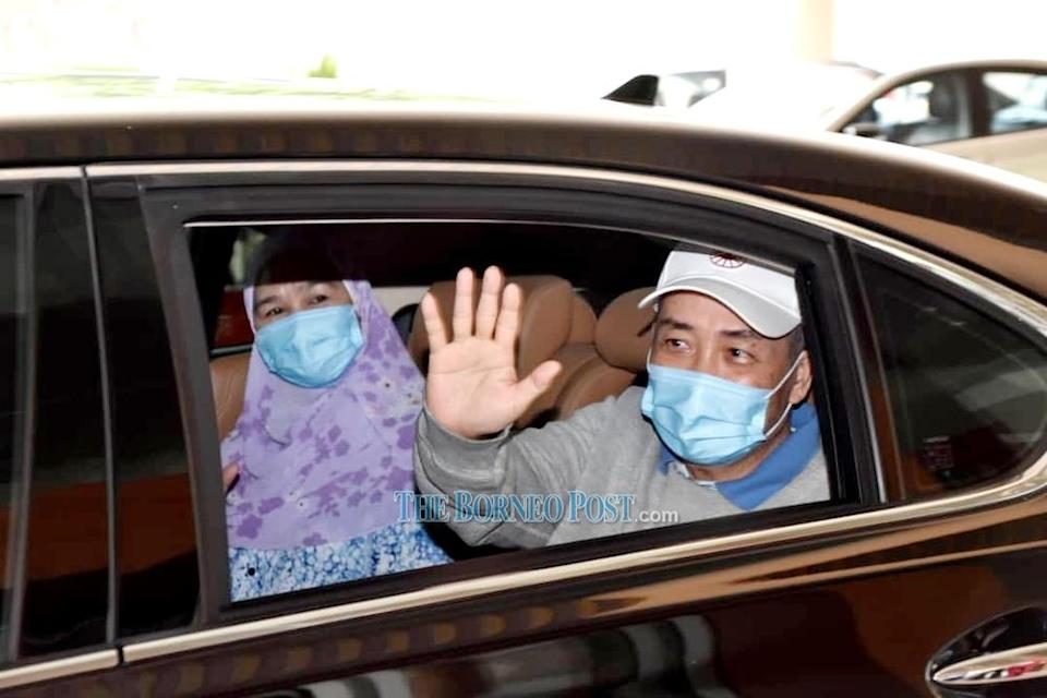 Datuk Seri Hajiji Noor and his wife Datin Seri Julia Salag wave to the medical personnel as they leave Queen Elizabeth Hospital. — Borneo Post Online pic