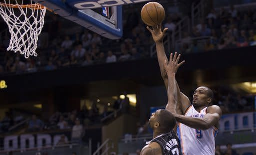 Oklahoma City Thunder's Serge Ibaka (9) shoots over Orlando Magic's Kyle Quinn during the second half of an NBA basketball game on Friday, March 22, 2013, in Orlando, Fla. The Thunder won 97-89. (AP Photo/Willie J. Allen Jr.)