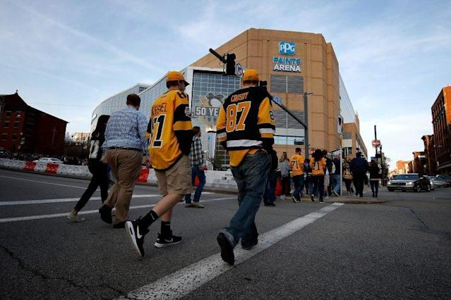 "<a class=""link rapid-noclick-resp"" href=""/nhl/teams/pit/"" data-ylk=""slk:Pittsburgh Penguins"">Pittsburgh Penguins</a> fans make their way to PPG Paints Arena as the Penguins battle the <a class=""link rapid-noclick-resp"" href=""/nhl/teams/cob/"" data-ylk=""slk:Columbus Blue Jackets"">Columbus Blue Jackets</a> in Game 1 of the first round of the Stanley Cup Playoffs. (Photo by Gregory Shamus/Getty Images)"