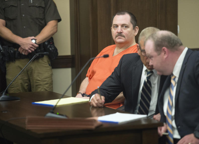 """FILE - In this June 19, 2018 file photo, Aubrey Trail, left, looks on during a hearing in Saline County Court, in Wilbur, Neb. Trail, on trial for the 2017 slaying of a Lincoln woman has slashed his neck and fallen from a wheelchair during court proceedings Monday, June 24, 2019. Aubrey Trail yelled """"Bailey is innocent, and I curse you all"""" before swiping what may have been a pen across his neck. He was soon taken to an ambulance. It's unclear how severely he injured himself. (Eric Gregory/Lincoln Journal Star via AP File)"""