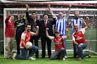 Players from the gay supporters' teams of Arsenal and Brighton pose for a photo during a penalty shoot-out competition at the Arsenal Hub in north London on October 1, 2017, ahead of the Premier League game between the two teams (AFP Photo/Chris J RATCLIFFE)