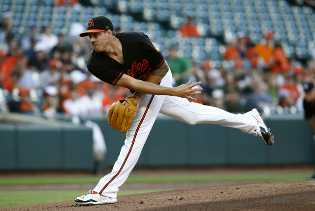Baltimore Orioles starting pitcher Kevin Gausman follows through to the Miami Marlins in the first inning of a baseball game, Friday, June 15, 2018, in Baltimore. (AP Photo/Patrick Semansky)