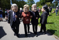 Activists dressed in giant papier-mache heads depicting G7 leaders participate in a march during a demonstration around the meeting of the G7 in Falmouth, Cornwall, England, Saturday, June 12, 2021. Leaders of the G7 gather for a second day of meetings on Saturday, in which they will discuss COVID-19, climate, foreign policy and the economy. (AP Photo/Alberto Pezzali)