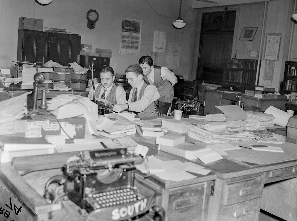 Associated Press editors are look over stories on election night, Nov. 8, 1938, in Washington, D.C. (AP Photo)