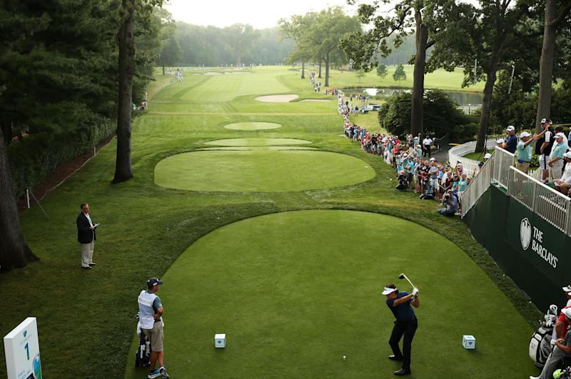 Phil Mickelson plays his shot from the first tee during the first round of The Barclays at The Ridgewood Country Club on August 21, 2014 in Paramus, New Jersey (AFP Photo/Darren Carroll)