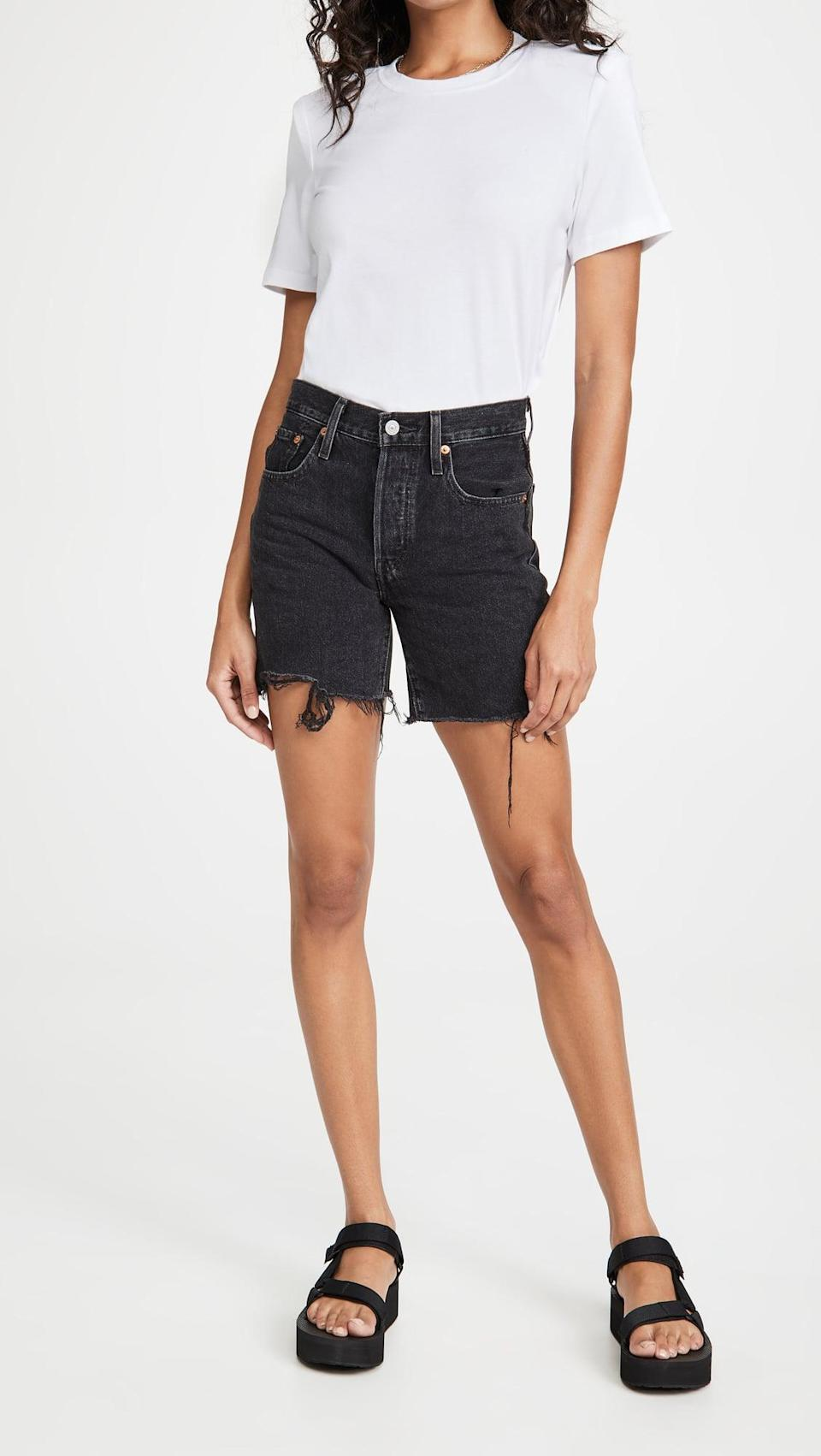 <p>What we like about these <span>Levi's 501 Mid Thigh Shorts</span> ($70) is that they're long enough to give you coverage, but short enough to still be flattering. Plus, you can't go wrong with black denim.</p>