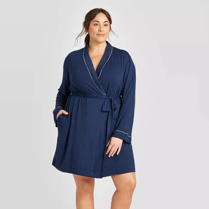 """<h2>Stars Above Plus Size Beautifully Soft Robe</h2><br>This 5-star rated robe is a year-round staple thanks to a chic and classic piped trim and cuffed sleeves.<br><br>One happy customer confirms this robe is just as soft as its name implies: """"So excited to wear this robe! I was looking for something lightweight, cozy and comfortable and this is definitely it. It's so soft and timeless.""""<br><br><strong>Stars Above</strong> Plus Size Beautifully Soft Robe, $, available at <a href=""""https://go.skimresources.com/?id=30283X879131&url=https%3A%2F%2Fgoto.target.com%2FXQedy"""" rel=""""nofollow noopener"""" target=""""_blank"""" data-ylk=""""slk:Target"""" class=""""link rapid-noclick-resp"""">Target</a>"""