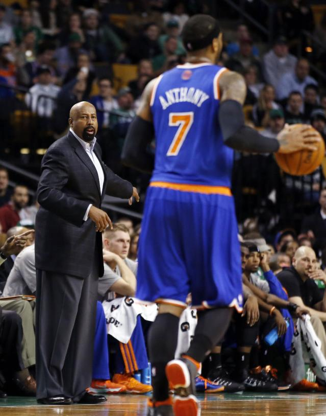 New York Knicks head coach Mike Woodson gives instruction as Knicks forward Carmelo Anthony (7) brings the ball upcourt during the second quarter of an NBA basketball game against the Boston Celtics in Boston, Wednesday, March 12, 2014. (AP Photo/Elise Amendola)