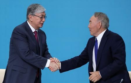 Kazakhstan's President Kassym-Jomart Tokayev shakes hands with former President Nursultan Nazarbayev at a congress of the Nur Otan ruling party in Nur-Sultan, Kazakhstan, April 23, 2019. REUTERS/Mukhtar Kholdorbekov