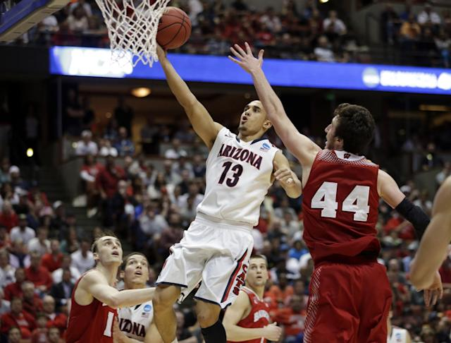 Arizona's Nick Johnson shoots during the second half in a regional final NCAA college basketball tournament game against Wisconsin, Saturday, March 29, 2014, in Anaheim, Calif. (AP Photo/Jae C. Hong)