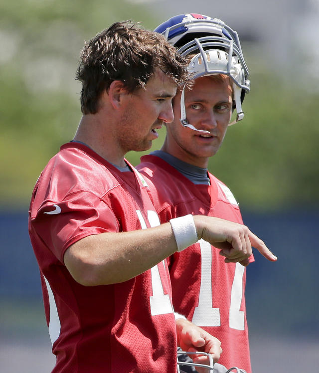 New York Giants quarterback Eli Manning (10) talks with quarterback Curtis Painter (17) during NFL football minicamp, Wednesday, June 18, 2014, in East Rutherford, N.J. (AP Photo/Julie Jacobson)