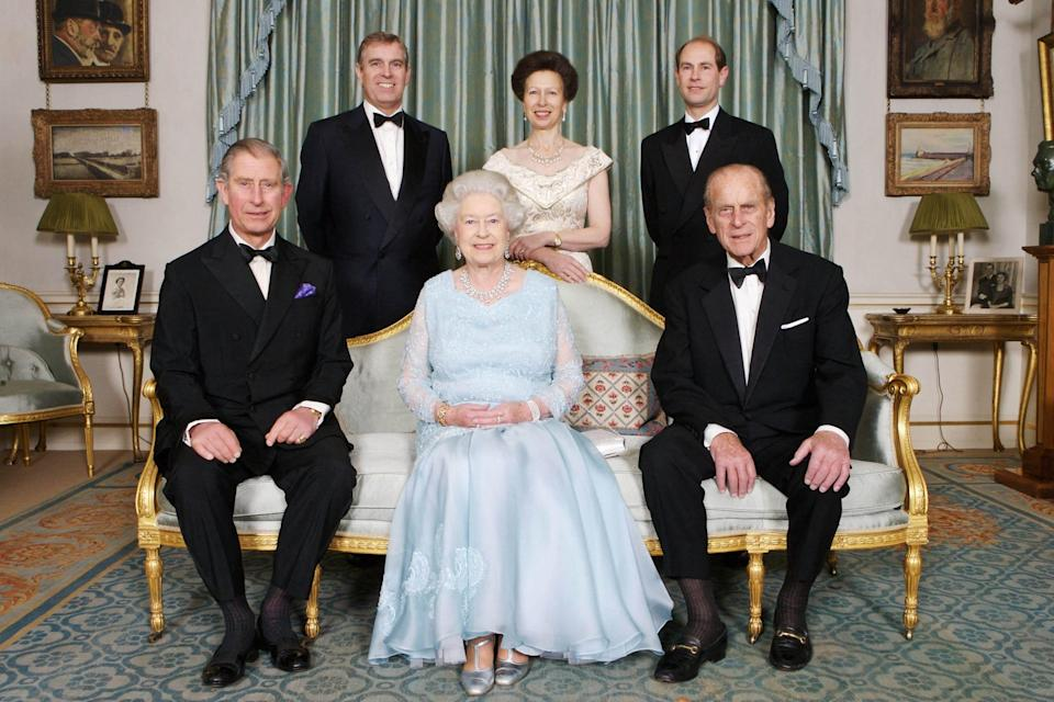 In this file photo taken Nov. 18, 2007, Britain's Queen Elizabeth II (front center) and Prince Philip, Duke of Edinburgh (front right) are joined at Clarence House in London by Prince Charles, (front left) Prince Edward, (back right) Princess Anne (back center) and Prince Andrew (back left) on Nov. 18, 2007.