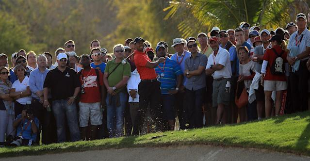 ABU DHABI, UNITED ARAB EMIRATES - JANUARY 29: Tiger Woods of the USA plays his second shot on the par 5, 18th hole during the final round of the Abu Dhabi HSBC Championship at the Abu Dhabi Golf Club on January 29, 2012 in Abu Dhabi, United Arab Emirates. (Photo by David Cannon/Getty Images)