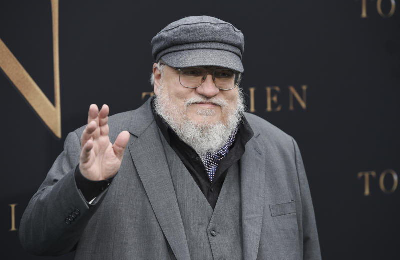 "Author George R.R. Martin waves to photographers at the premiere of the film ""Tolkien,"" at the Regency Village Theatre, Wednesday, May 8, 2019, in Los Angeles. (Photo by Chris Pizzello/Invision/AP)"