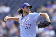 Kansas City Royals starting pitcher Jackson Kowar throws during the first inning of a baseball game against the Seattle Mariners Sunday, Sept. 19, 2021, in Kansas City, Mo. (AP Photo/Charlie Riedel)