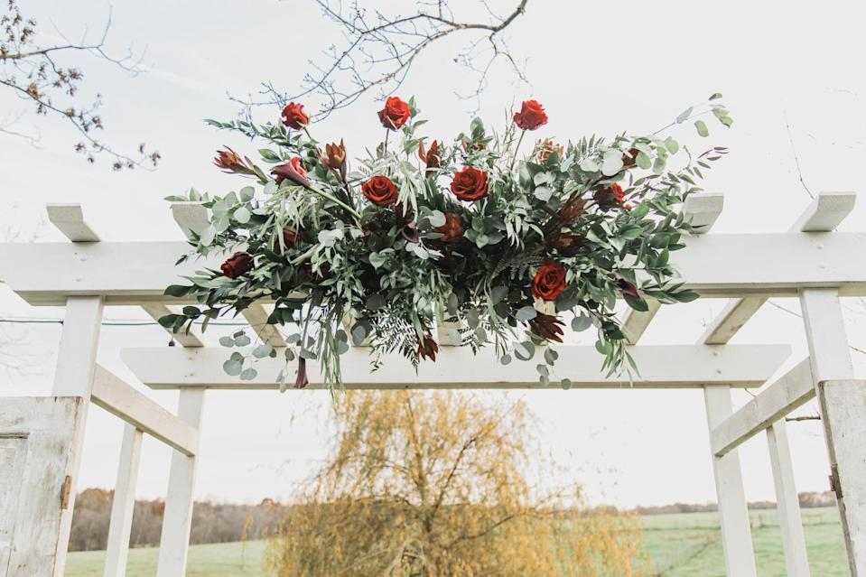 <p>You can take the typical vow backdrop to a place it has never been before by just adding flowers and plants to it. Simply use a hot glue gun to affix the greenery onto the backdrop, and your work here is done!</p>