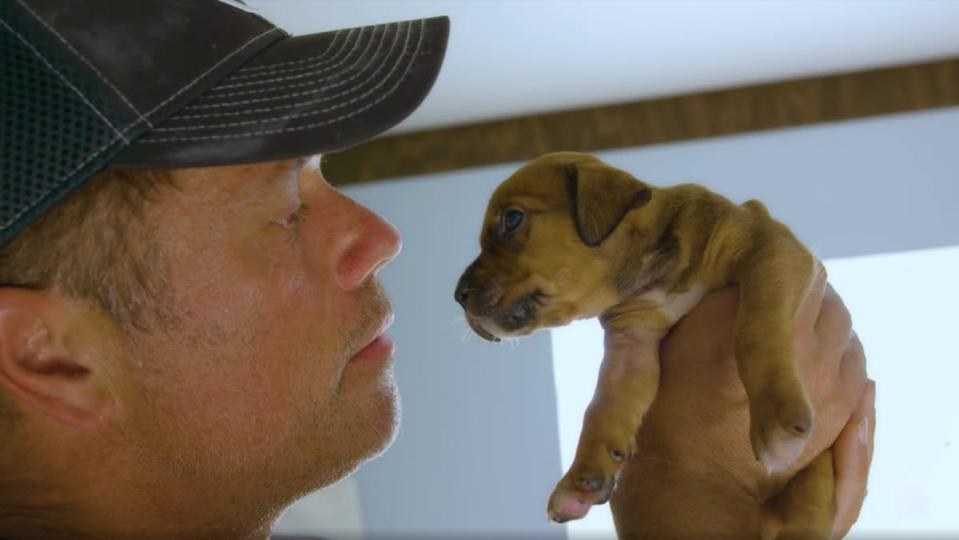 Doug Thron creator of drone animal rescue technology with puppy