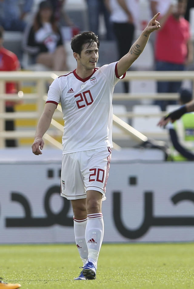 Iran's forward Sardar Azmoun celebrates after scoring his side's opening goal during the AFC Asian Cup group D soccer match between Iran and Vietnam at Al Nahyan Stadium in Abu Dhabi, United Arab Emirates, Saturday, Jan. 12, 2019. (AP Photo/Kamran Jebreili)