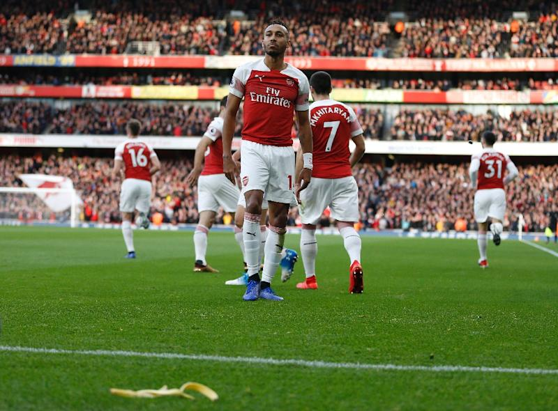 The Tottenham Hotspur fan who threw a banana skin onto the pitch during the match with Arsenal has been charged with throwing a missile and not a racially aggravated offence