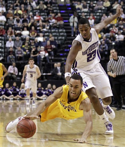 Minnesota guard Joe Coleman, left, dives for a loose ball against Northwestern guard JerShon Cobb in the second half of an NCAA college basketball game at the first round of the Big Ten Conference tournament in Indianapolis, Thursday, March 8, 2012. (AP Photo/Michael Conroy)